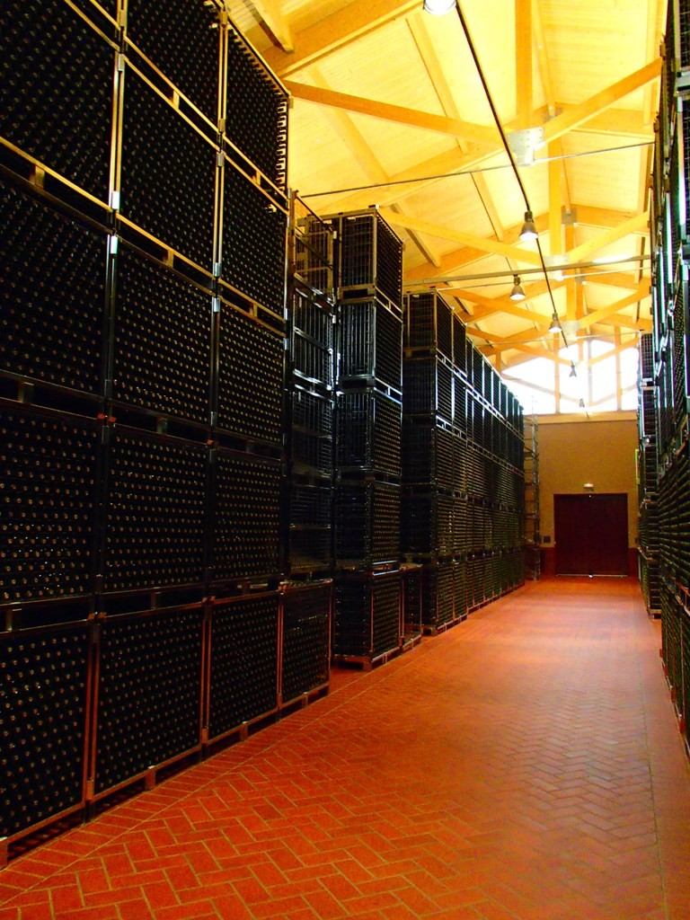 The aging room where wines will spend 2 years or up to several decades in bottle until deemed ready are neatly and efficiently stacked in metal cubes.